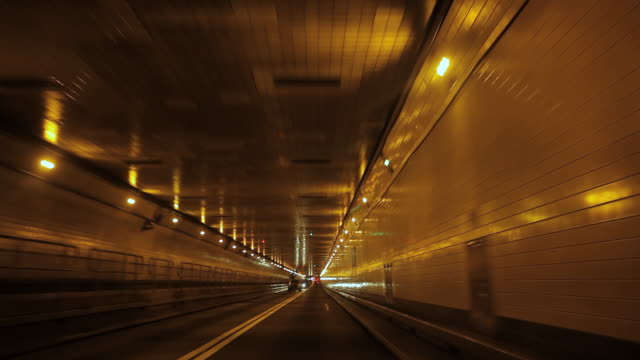 WS POV Shot from car travelling through Lincoln Tunnel