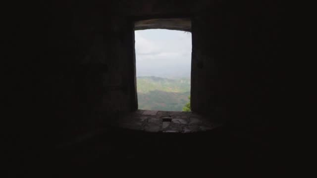 shot from darkness of interior toward and through light of open window - castle stock videos & royalty-free footage