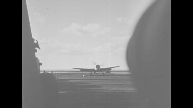 shot from deck of carrier of plane landing on deck / plane crashing into ocean next to carrier / pilot standing on wing of plane floating in water /... - world water day stock videos and b-roll footage