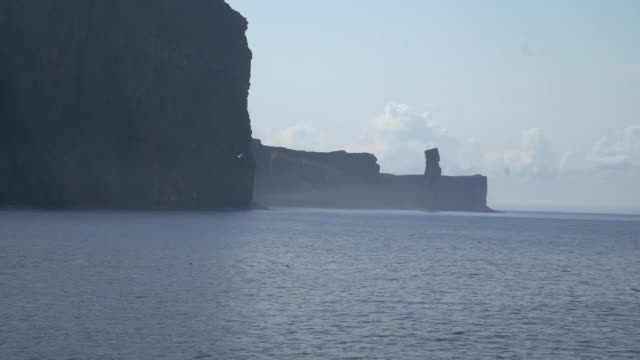 shot from ferry on the move the old man of hoy is a 449foot sea stack on hoy part of the orkney archipelago off the north coast of scotland formed... - cloud sky stock videos & royalty-free footage