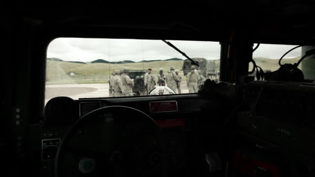 Shot from inside of Humvee of soldiers outside.
