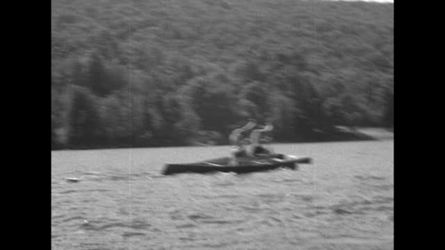shot from moving canoe of singleman canoes racing / two shots from moving canoe with man shouting through megaphone of singleman canoes ahead racing... - bobsleighing stock videos & royalty-free footage
