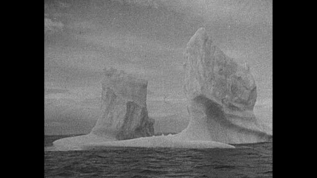 shot from on board ship effie m morrissey of ship's prow plowing through rough seas / two shots from ship of icebergs / two close shots of iceberg /... - effie stock videos and b-roll footage