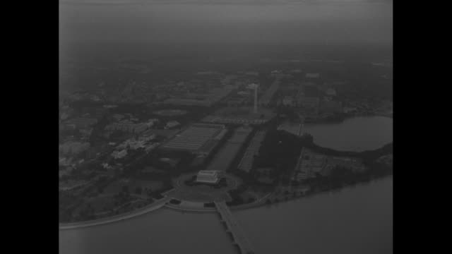 shot from plane of formation of planes flying over city during parade honoring adm. chester nimitz, commander in chief of the pacific fleet / shot... - potomac river stock-videos und b-roll-filmmaterial