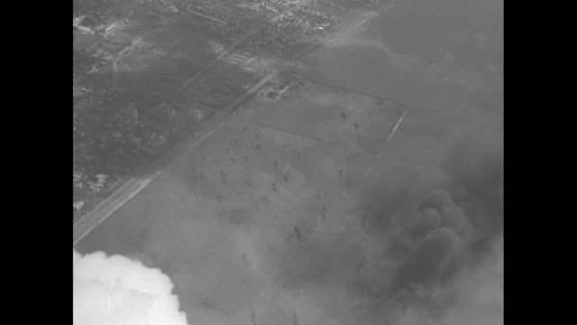 shot from plane of formation of us warplanes / two closer views of planes in flight / two aerial shots of smoke rising from cavite province / close... - allied forces stock videos & royalty-free footage