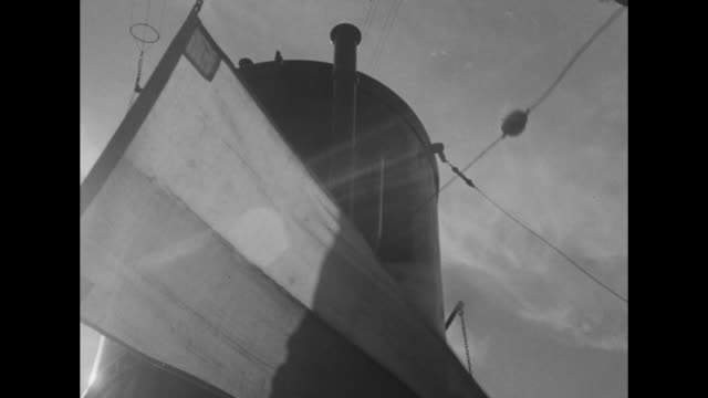 shot from ss united states of passengers on deck of another ship as united states passes it / shot on board united states of steam coming out of... - atlantik stock-videos und b-roll-filmmaterial
