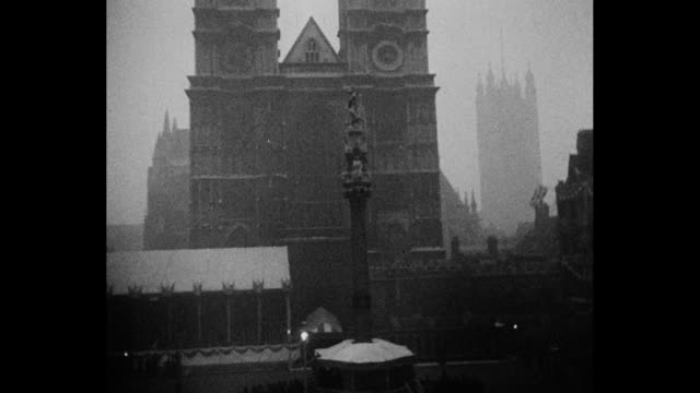 shot from street level of towers of westminster abbey / pan down to small square with column in middle / still photo of ceremony inside abbey, prince... - archbishop of canterbury stock videos & royalty-free footage