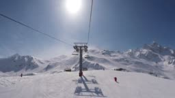 Shot From The Chair Lift Rises To The Top Of The Mountain In Winter Ski Resort