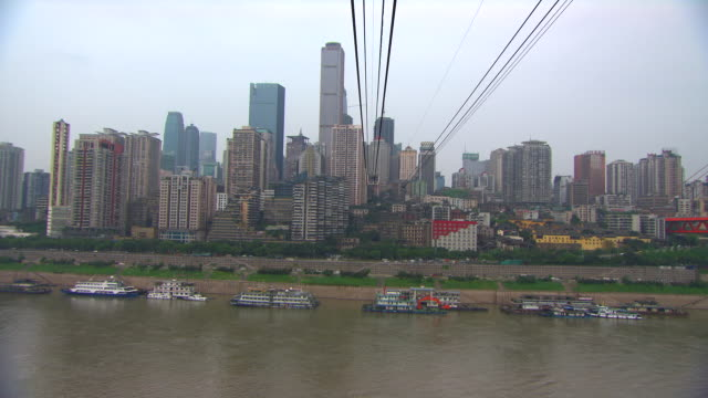 POV shot from the Chongqing cable car as it travels over the Yangtze River.