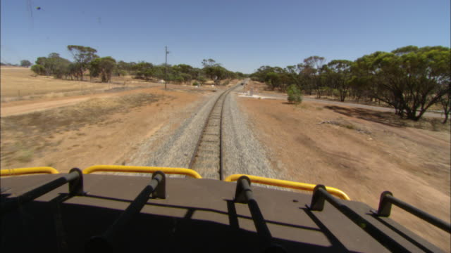 pov shot from the driver cabin of a goods train as it travels through western australia. - cargo train stock videos & royalty-free footage