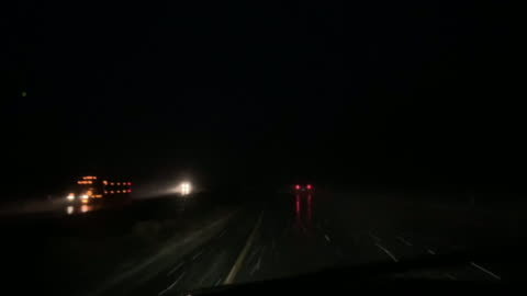 shot from the front of a moving vehicle with traffic during a snowstorm at night - truck stock videos & royalty-free footage