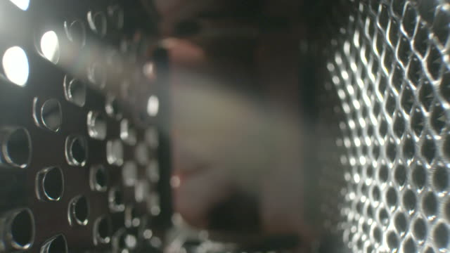 POV shot inside a metal grater.