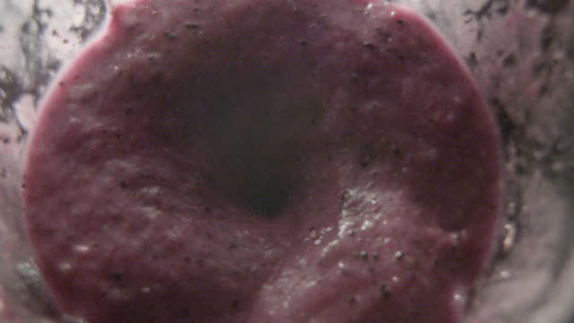 pov shot inside an electric blender as it purees pitaya fruit. - smoothie stock videos & royalty-free footage