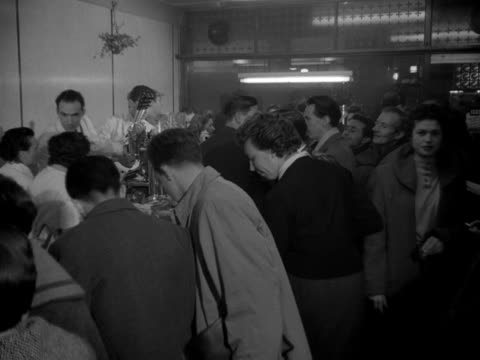 a shot inside the busy moka coffee bar in soho 1954 - bbc archive stock-videos und b-roll-filmmaterial