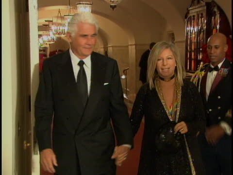 shot james brolin and barbra streisand holding hands and walking down hall at white house receiption - james brolin stock videos & royalty-free footage