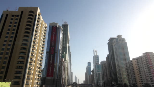 POV shot moving past skyscrapers in the city of Dubai.