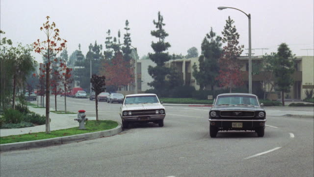 ms ts shot of 1970 blue ford mustang car at apartment district  - ford mustang stock videos and b-roll footage
