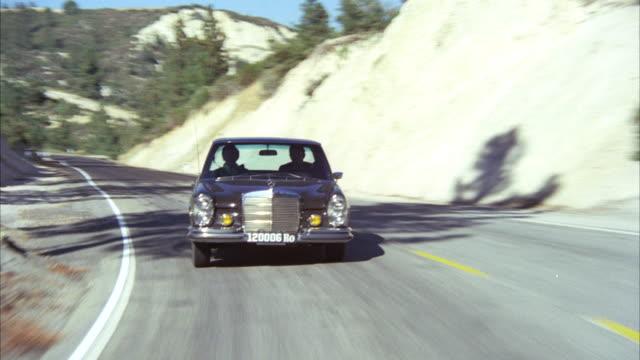 ms pov shot of 1972 black mercedes sedan on mountain highway - on the move video stock e b–roll