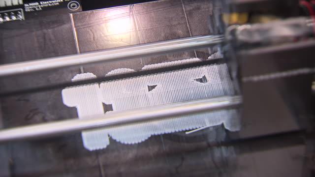 Shot of 3D Printer writing Korean Script