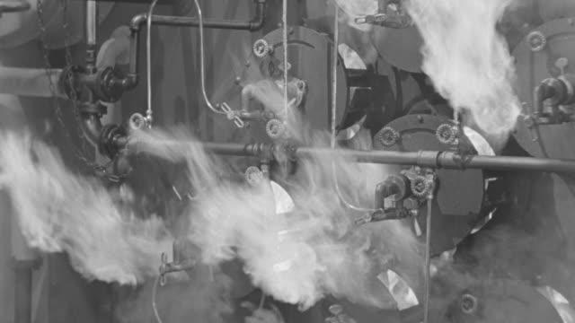 stockvideo's en b-roll-footage met ms shot of  934 anchors ships engine room boiler with flames  - machinekamer