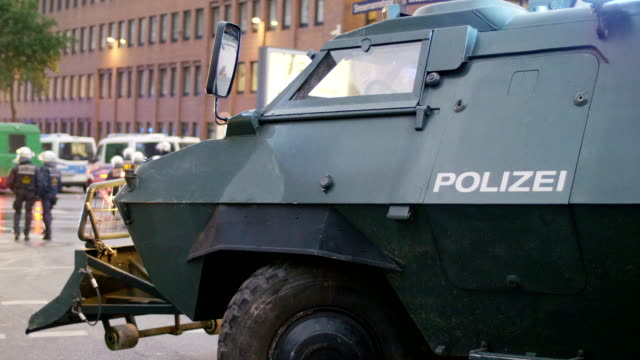 shot of a armored police truck during g20 summit in hamburg 2017 - armored truck stock videos and b-roll footage
