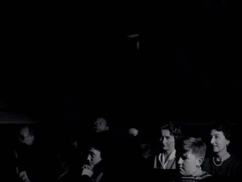 shot of a audience laughing and clapping in a darkened cinema auditorium. 1960. - film industry stock videos & royalty-free footage