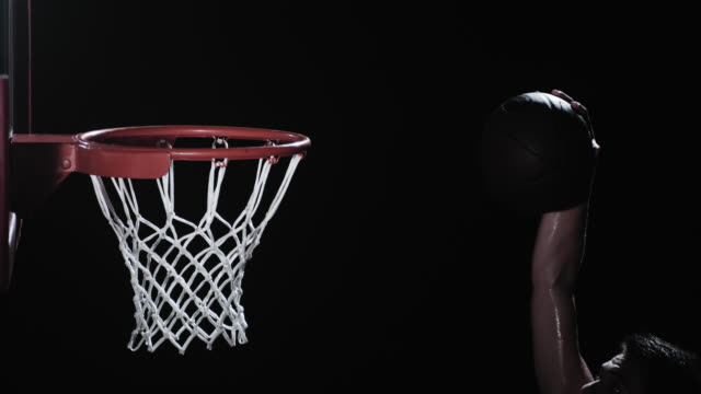 SLO MO shot of a basketball player performing the slam dunk