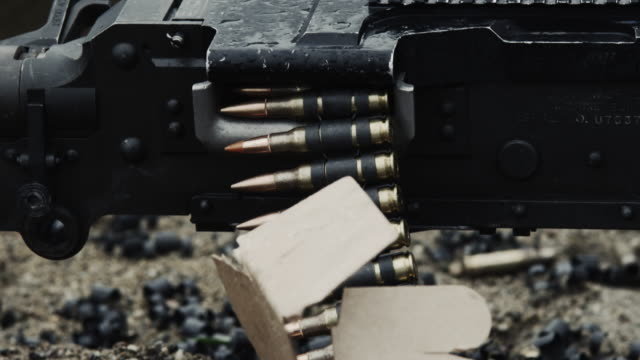 shot of a belt-fed machine gun as it is fired. - machine gun stock videos & royalty-free footage