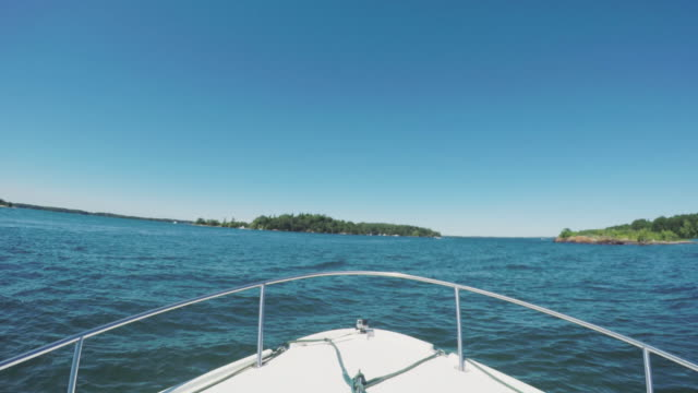 POV shot of a boat floating through the St. Lawrence River.