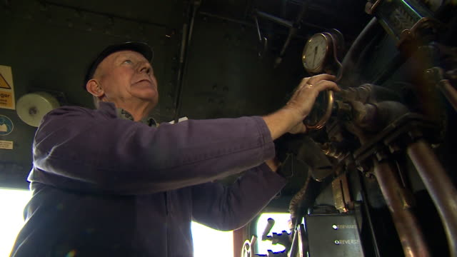 shot of a brass valve being turned by a crew member in the cabin of the flying scotsman - metal blend stock videos and b-roll footage