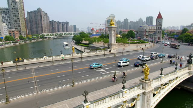 aerial shot of a bridge spans the hai river in downtown/tianjin,china - hai river stock videos & royalty-free footage