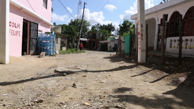 santa domingo dominican republic november 29 2012 shot of a broken and dusty road in the poor neighbourhood 'los alcarrizos' in santa domingo while a... - hispaniola stock videos and b-roll footage