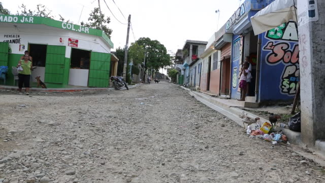santa domingo dominican republic november 29 2012 a shot of a broken and dusty road in the poor neighbourhood 'los alcarrizos' in santa domingo while... - santo domingo dominican republic stock videos & royalty-free footage
