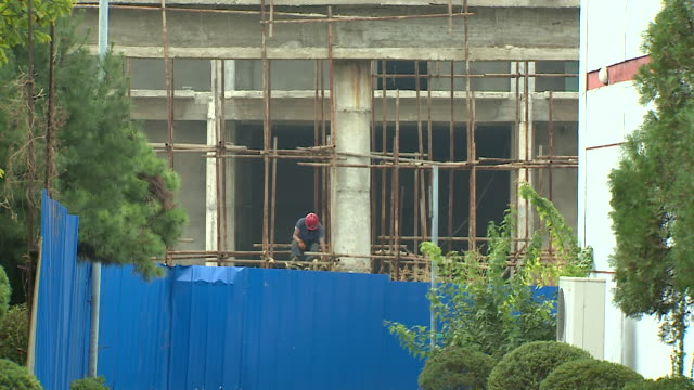 shot of a building site in pyongyang - pyongyang stock videos and b-roll footage