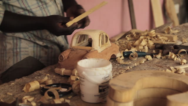 shot of a carpenter working on a wooden model of a car. - ghana stock videos and b-roll footage