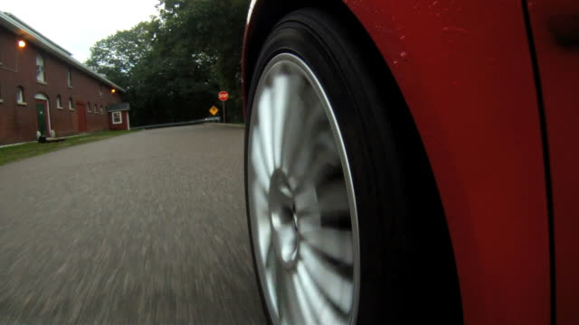 Shot of a cars wheel as it accelerates, and goes for a drive.