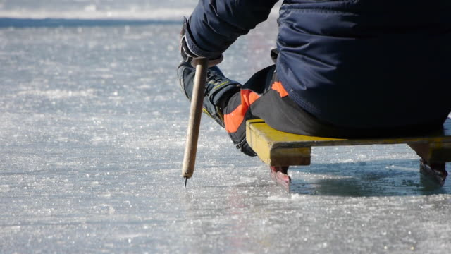 shot of a child sledging on the ice - winter sport stock videos and b-roll footage