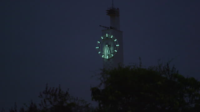 shot of a clock tower at night in rio de janeiro, brazil - clock tower stock videos & royalty-free footage