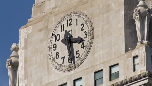 Shot of a clock tower's clock advancing one minute in New York City