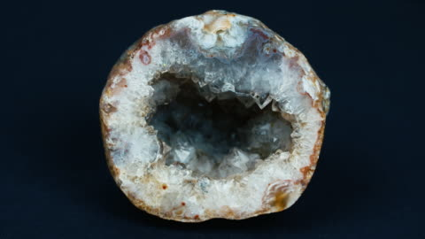 shot of a cross section of a geode slowly revolving, displaying a beautiful crystal interior. - mineral stock videos & royalty-free footage