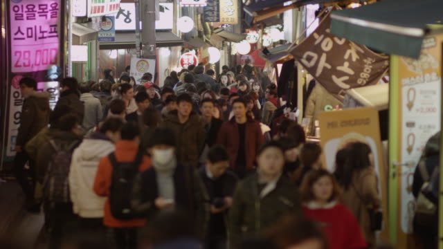 Shot of a crowded Seoul street at night