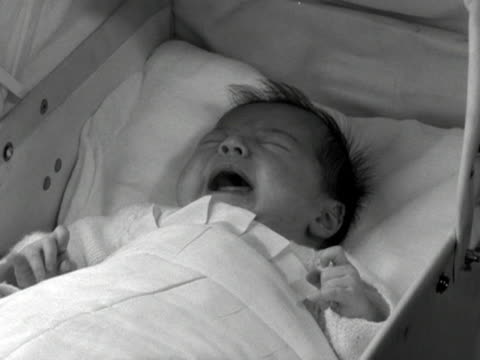 shot of a crying baby in a carry cot - bedclothes stock videos & royalty-free footage