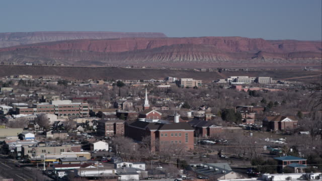 vidéos et rushes de shot of a desert city from a near hillside. - provo
