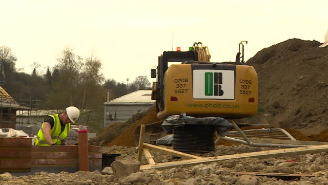 Shot of a digger moving soil on a construction site