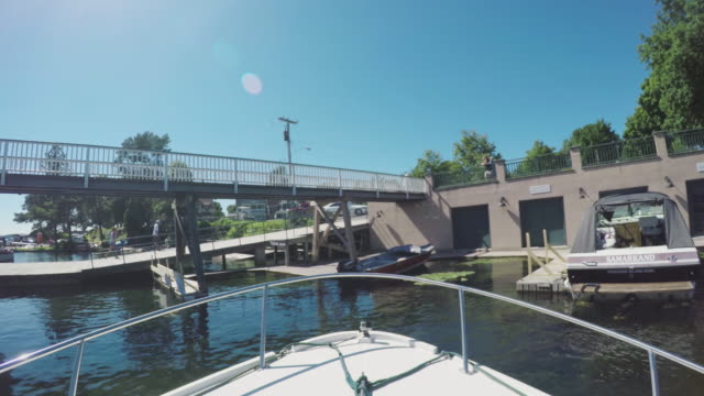 POV shot of a docking boat in the St. Lawrence River - 4k