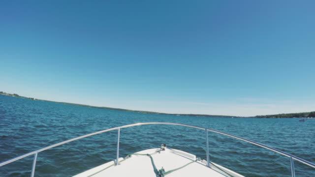 POV shot of a docking boat in the St. Lawrence River - 4k