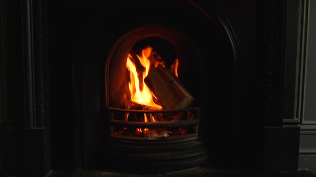 shot of a fierce fire blazing in an open fireplace - fireplace stock videos and b-roll footage