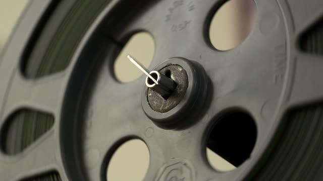 stockvideo's en b-roll-footage met cu shot of a film reel moving - sprocket