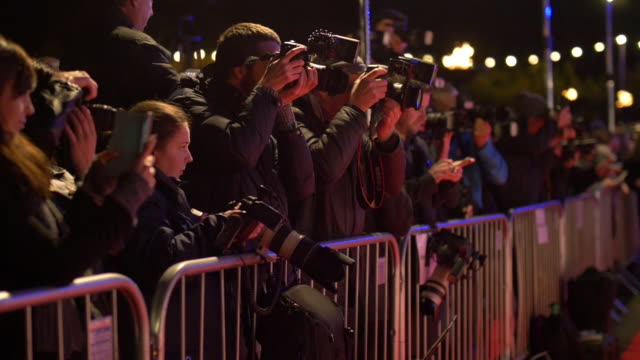 Shot of a group of paparazzi photographers shooting celebrities at a red carpet premiere event