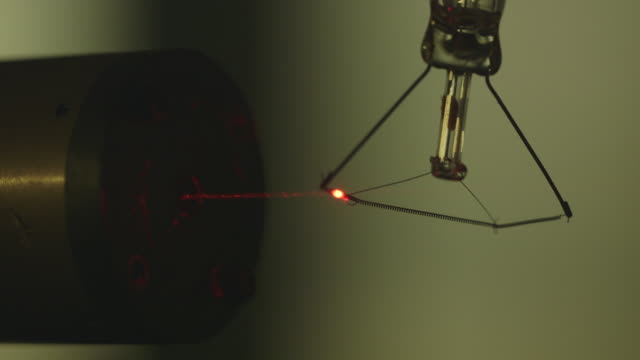 shot of a laser beam hitting an old light bulb filament. - filament stock videos & royalty-free footage